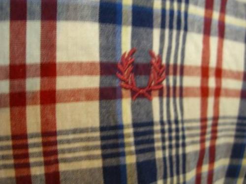 草加衣類のポロシャツ