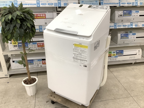 生活家電の縦型洗濯乾燥機