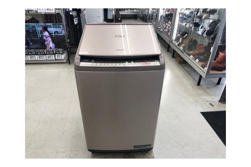 家事家電の縦型洗濯乾燥機